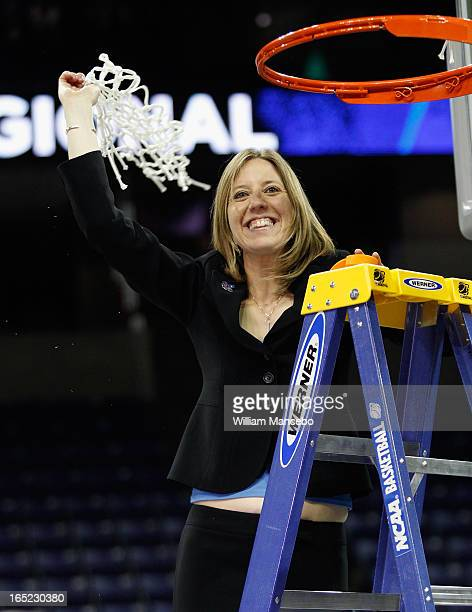 Head coach Lindsay Gottlieb of the California Golden Bears celebrates after cutting off the net after the game against the Georgia Lady Bulldogs...