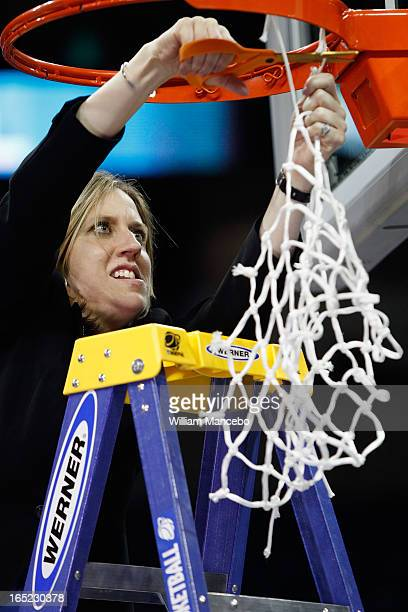 Head coach Lindsay Gottlieb of the California Golden Bears cuts off the net after the game against the Georgia Lady Bulldogs during the NCAA Division...