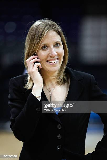 Head coach Lindsay Gottlieb of the California Golden Bears has a phone conversation after the game against the Georgia Lady Bulldogs during the NCAA...