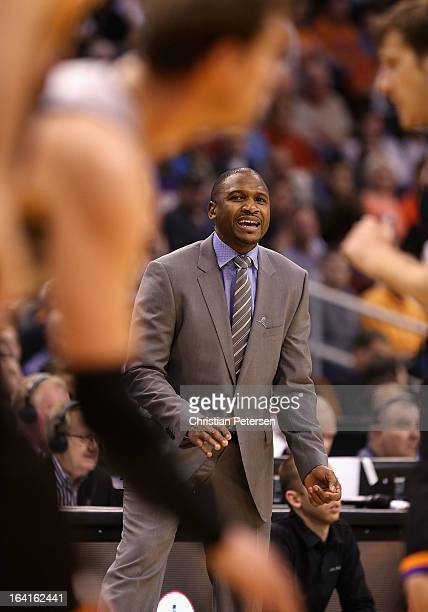 Head coach Lindsey Hunter of the Phoenix Suns reacts during the NBA game against the San Antonio Spurs at US Airways Center on February 24 2013 in...