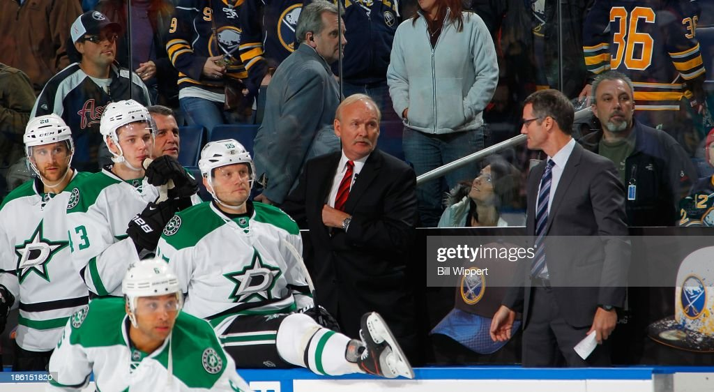 Head coach <a gi-track='captionPersonalityLinkClicked' href=/galleries/search?phrase=Lindy+Ruff&family=editorial&specificpeople=243071 ng-click='$event.stopPropagation()'>Lindy Ruff</a> (C) and assistant coach <a gi-track='captionPersonalityLinkClicked' href=/galleries/search?phrase=James+Patrick&family=editorial&specificpeople=206860 ng-click='$event.stopPropagation()'>James Patrick</a> (R) of the Dallas Stars watch the final seconds of their 4-3 victory against the Buffalo Sabres on October 28, 2013 at the First Niagara Center in Buffalo, New York.