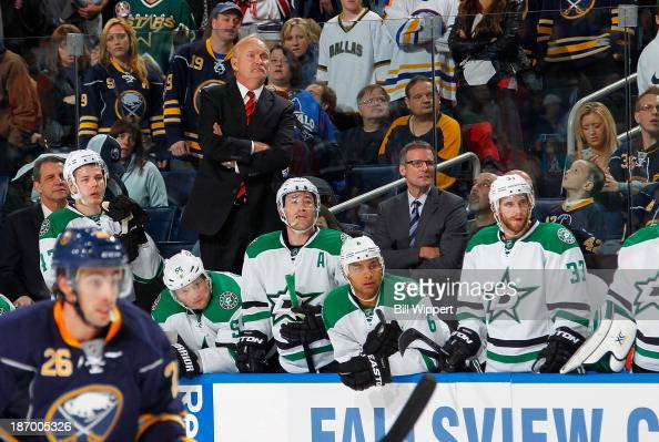 Head coach Lindy Ruff and assistant coach James Patrick of the Dallas Stars watch the action in their return to Buffalo for a game against the Sabres...