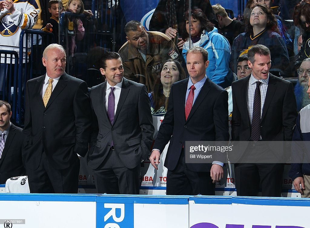 Head coach Lindy Ruff assistant coaches Teppo Numminen Kevyn Adams and James Patrick of the Buffalo Sabres are introduced before playing the...