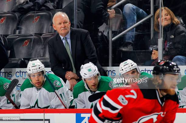 Head Coach Lindy Ruff of the Dallas Stars looks on during the game against the New Jersey Devils on March 26 2017 at Prudential Center in Newark New...