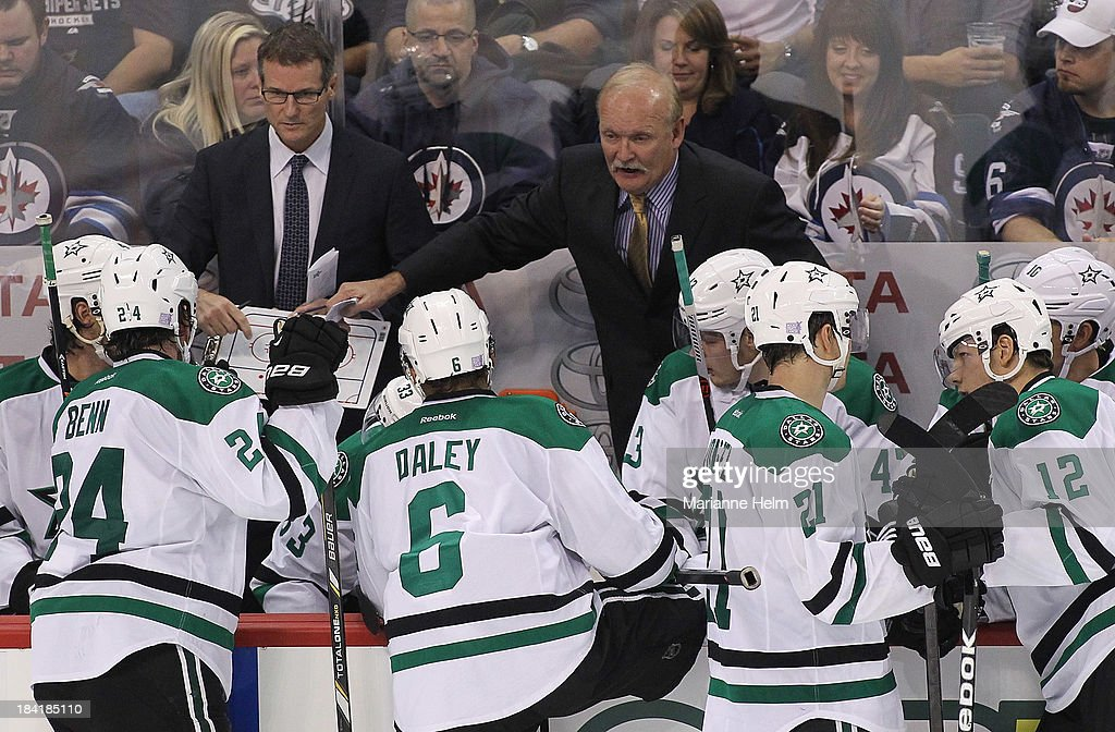 Head coach <a gi-track='captionPersonalityLinkClicked' href=/galleries/search?phrase=Lindy+Ruff&family=editorial&specificpeople=243071 ng-click='$event.stopPropagation()'>Lindy Ruff</a> of the Dallas Stars talks to his players from the bench in third-period action of an NHL game against the Winnipeg Jets at the MTS Centre on October 11, 2013 in Winnipeg, Manitoba, Canada.
