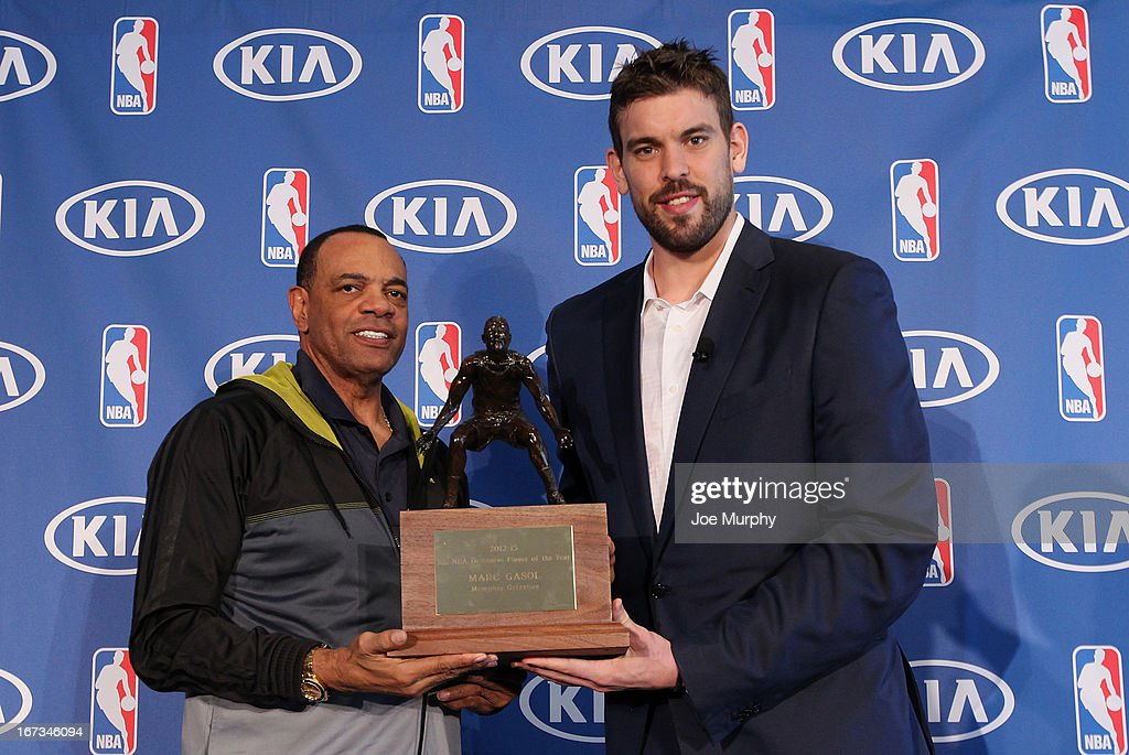 Head Coach Lionel Hollins and Marc Gasol of the Memphis Grizzlies poses for a portrait with the NBA Defensive Player of the Year award during a press conference on April 24, 2013 at FedExForum in Memphis, Tennessee.