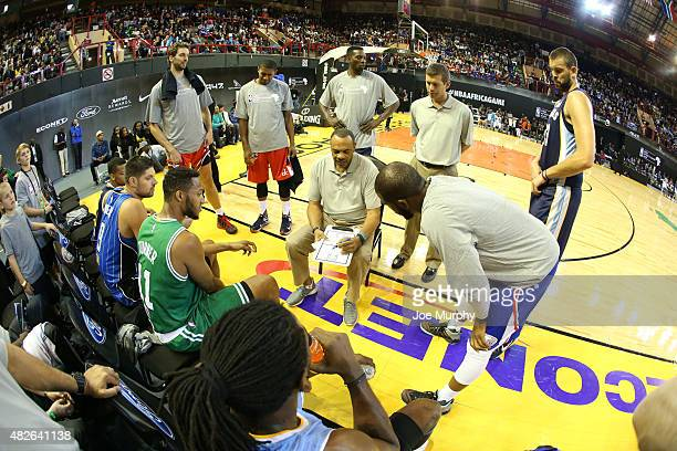 Head Coach Lionel Hollins of Team World goes over the game plan against Team Africa during the NBA Africa Game 2015 as part of Basketball Without...