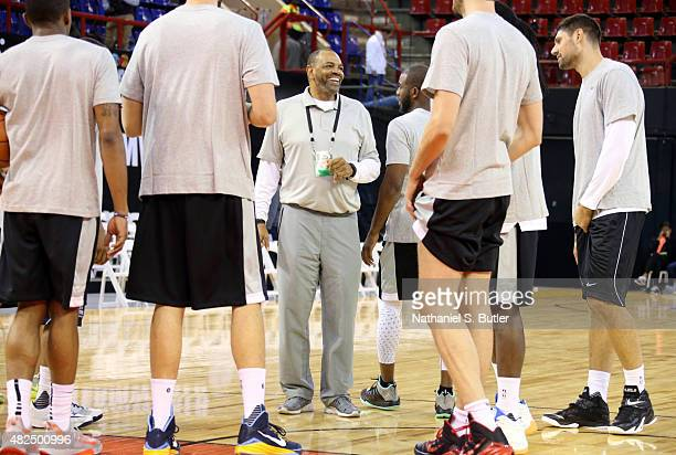 Head Coach Lionel Hollins of Team World smiles during a huddle at practice for the NBA Africa Game 2015 as part of Basketball Without Borders on July...
