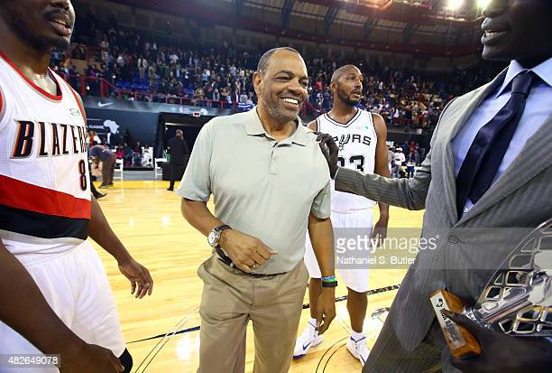 Head Coach Lionel Hollins of Team World smiles with NBA Africa Vice President Managing Director Amadou Gallo Fall after the NBA Africa Game 2015 as...