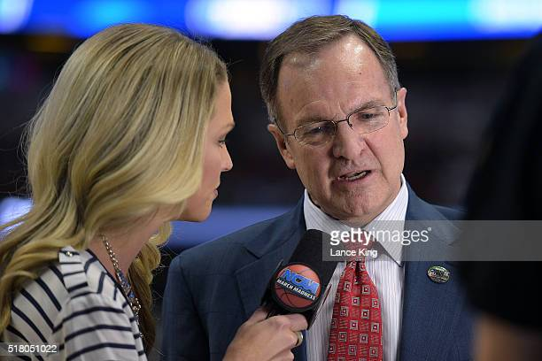 Head coach Lon Kruger of the Oklahoma Sooners is interviewed by TBS sideline reporter Allie LaForce during their game against the Texas AM Aggies...