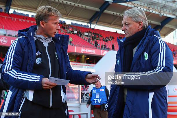 Head coach LorenzGuenther Koestner of Wolfsburg chats with assistant coach Andries Jonker prior to the Bundesliga match between 1 FC Nuernberg and...