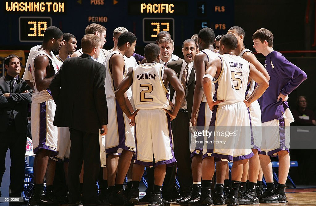 Head coach Lorenzo Romar of the Washington Huskies talks to his team during a time out from the 2005 NCAA division 1 men's basketball championship...