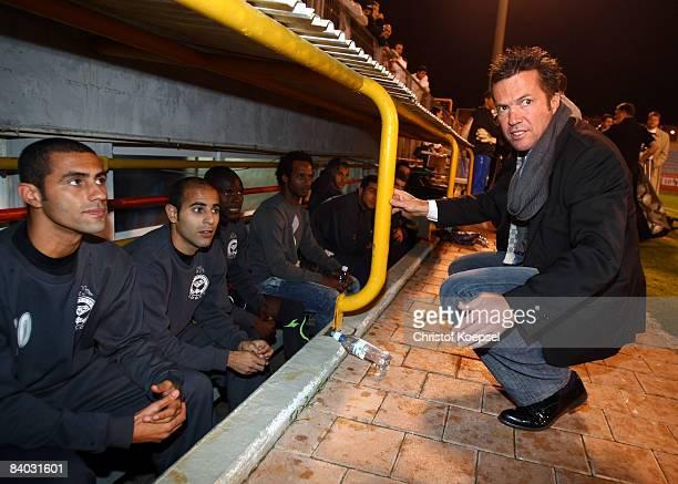 Head coach Lothar Matthaeus of Netanya speaks to his team before the 'goals for peace 2008' friendly match between Maccabi Netanya and Borussia...