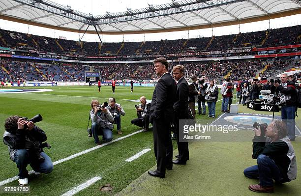 Head coach Louis van Gaal and assistant coach Andries Jonker of Muenchen watch their team warming up before the Bundesliga match between Eintracht...