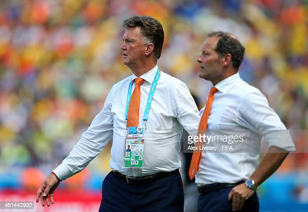 Head coach Louis van Gaal and coach Danny Blind of the Netherlands look on during the 2014 FIFA World Cup Brazil Round of 16 match between...