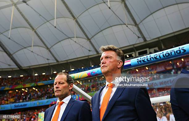 Head Coach Louis van Gaal and his assistant Danny Blind stand for the national anthem prior to the 2014 FIFA World Cup Brazil Quarter Final match...