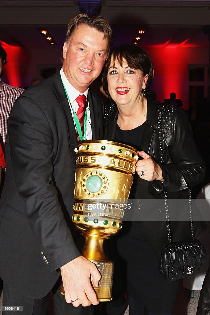 Head coach Louis van Gaal and his wife Truus pose with the DFB Cup trophy the Bayern Muenchen Champions Party after the DFB Cup Final match against Werder Bremen at DeutscheTelekom Representative House on May 15, 2010 in Berlin, Germany.