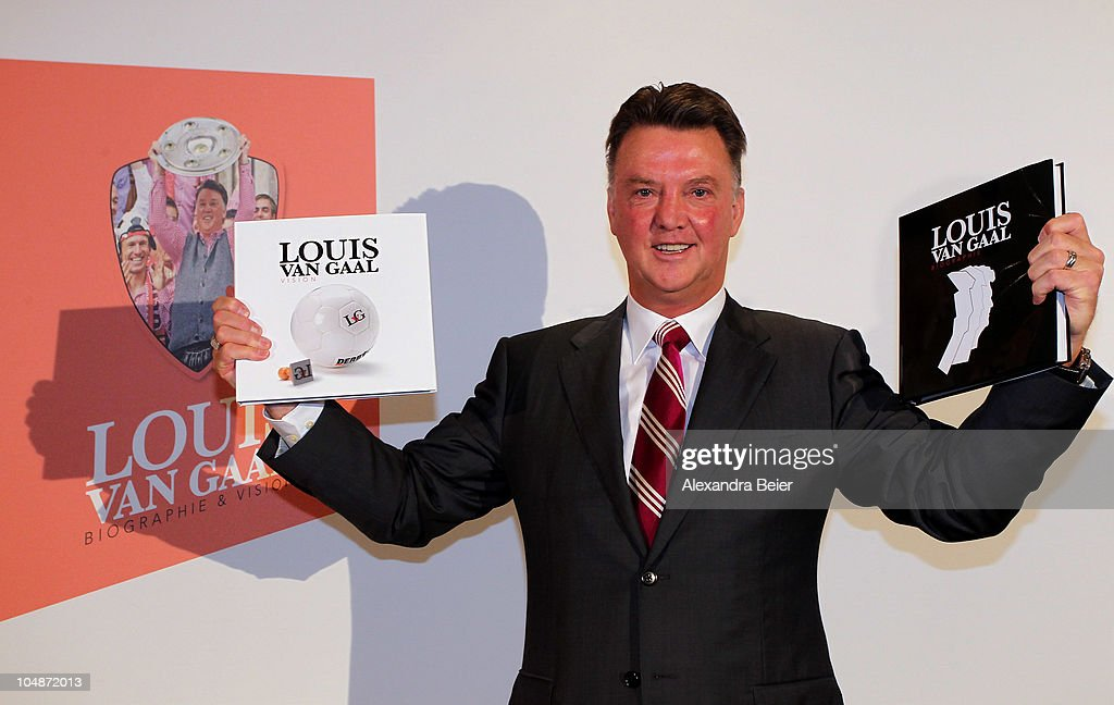 Head coach Louis van Gaal of Bayern Muenchen poses with his book 'Louis van Gaal Biography Vision' he presented on October 6 2010 in Munich Germany