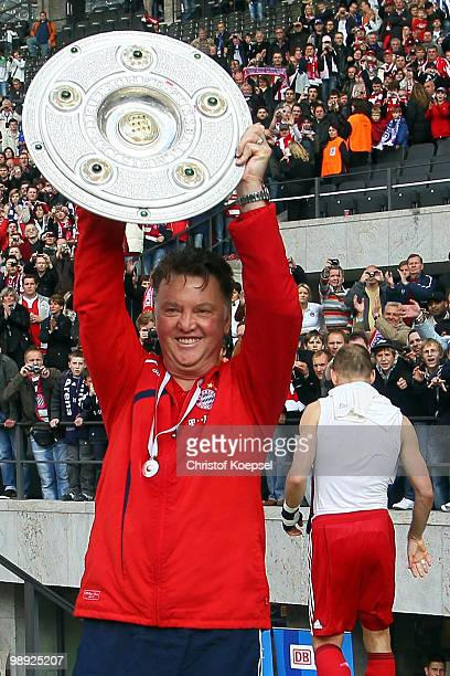 Head coach Louis van Gaal of Bayern presents the German championship trophy after winning 31 the Bundesliga match between Hertha BSC Berlin and FC...
