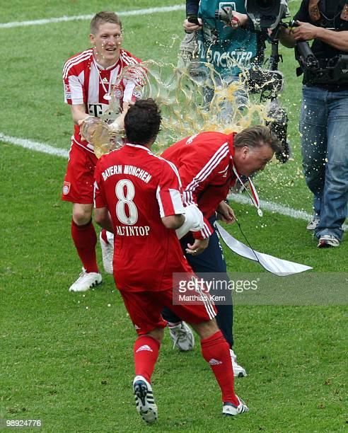Head coach Louis van Gaal of Bayern receives a beer shower of Bastian Schweinsteiger and Hamit Altintop after the Bundesliga match between Hertha BSC...
