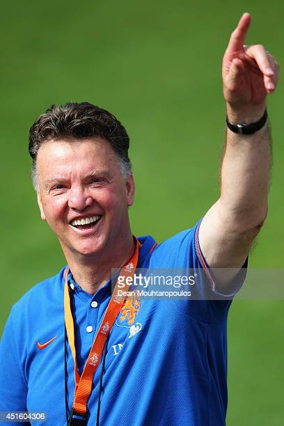 Head coach Louis van Gaal of the Netherlands laughs during the Netherlands training session at the 2014 FIFA World Cup Brazil held at the Estadio...