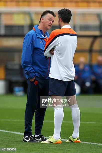 Head coach Louis van Gaal speaks to Robin van Persie during the Netherlands training session at the 2014 FIFA World Cup Brazil held at the Estadio...