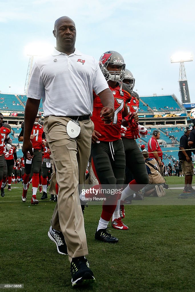 Head coach Lovie Smith of the Tampa Bay Buccaneers leaves the field prior to a preseason game against the Jacksonville Jaguars at EverBank Field on August 8, 2014 in Jacksonville, Florida.