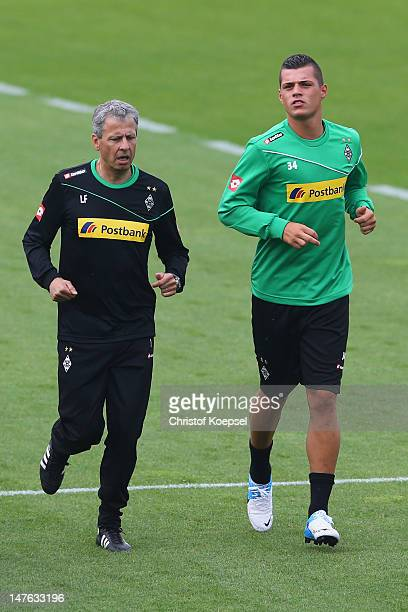 Head coach Lucien Favre and Granit Xhaka during the training session of Borussia Moenchengladbach the club's training ground on Jul 2 2012 in...