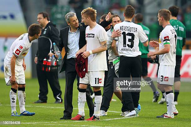 Head coach Lucien Favre and Marco Reus of Moenchengladbach celebrate after winning 21 the Bundesliga match between Borussia Moenchengladbach and...