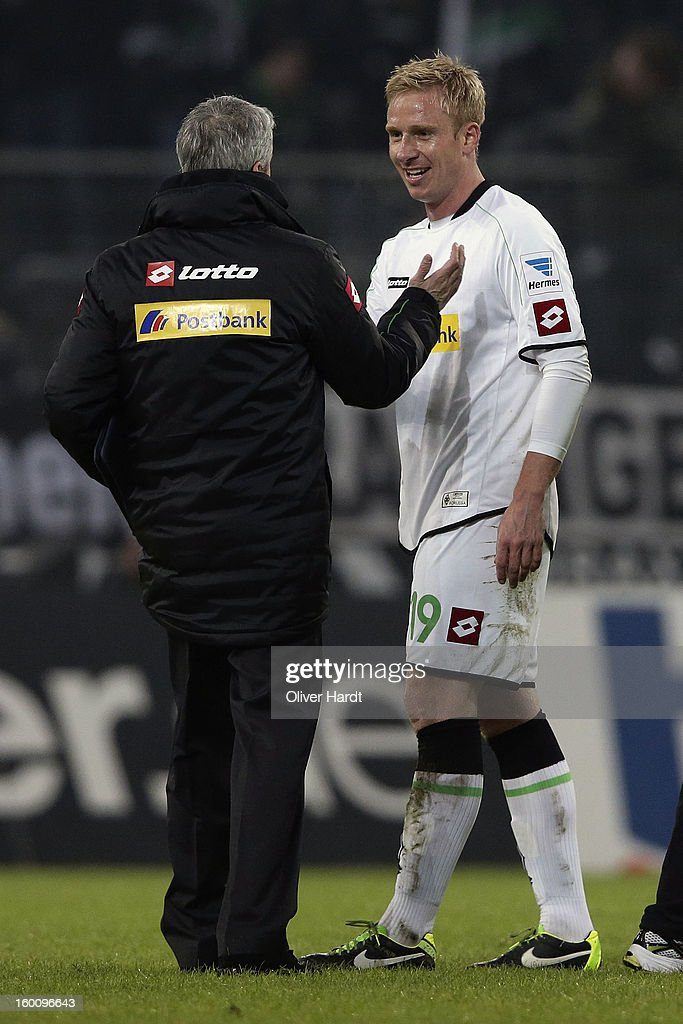 Head coach Lucien Favre (L) and Mike Hanke (R) of Gladbach celebrate after the Bundesliga match between VfL Borussia Moenchengladbach v Fortuna Duesseldorf at Borussia Park Stadium on January 26, 2013 in Moenchengladbach, Germany.