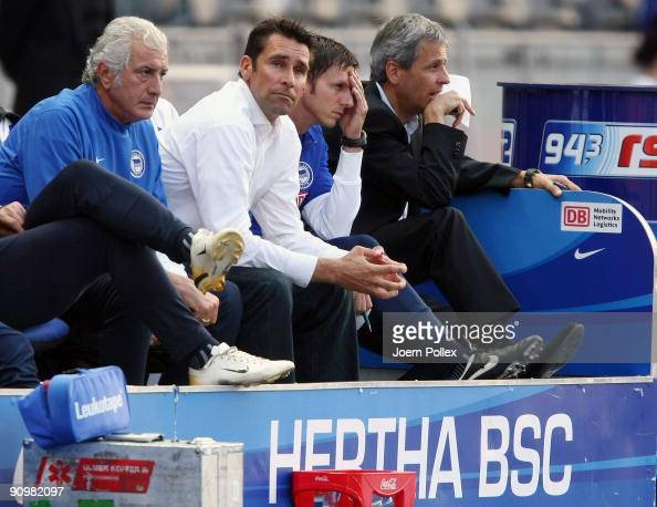 Head coach Lucien Favre of Berlin and Manager Michael Preetz of Berlin look on during the Bundesliga match between Hertha BSC Berlin and SC Freiburg...