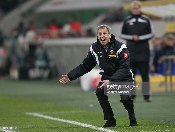 Head coach Lucien Favre of Gladbach issues instructions during the Bundesliga match between Borussia Moenchengladbach and FC Schalke 04 at Borussia...