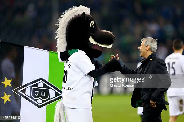 Head coach Lucien Favre of Moenchengladbach celebrates with mascot Juenter his birthday after the Bundesliga match between Borussia Moenchengladbach...