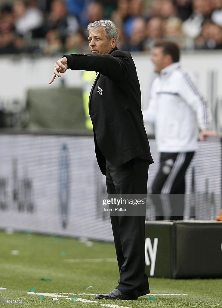Head coach <a gi-track='captionPersonalityLinkClicked' href=/galleries/search?phrase=Lucien+Favre&family=editorial&specificpeople=4313368 ng-click='$event.stopPropagation()'>Lucien Favre</a> of Moenchengladbach gestures during the Bundesliga match between at Volkswagen Arena on May 10, 2014 in Wolfsburg, Germany.
