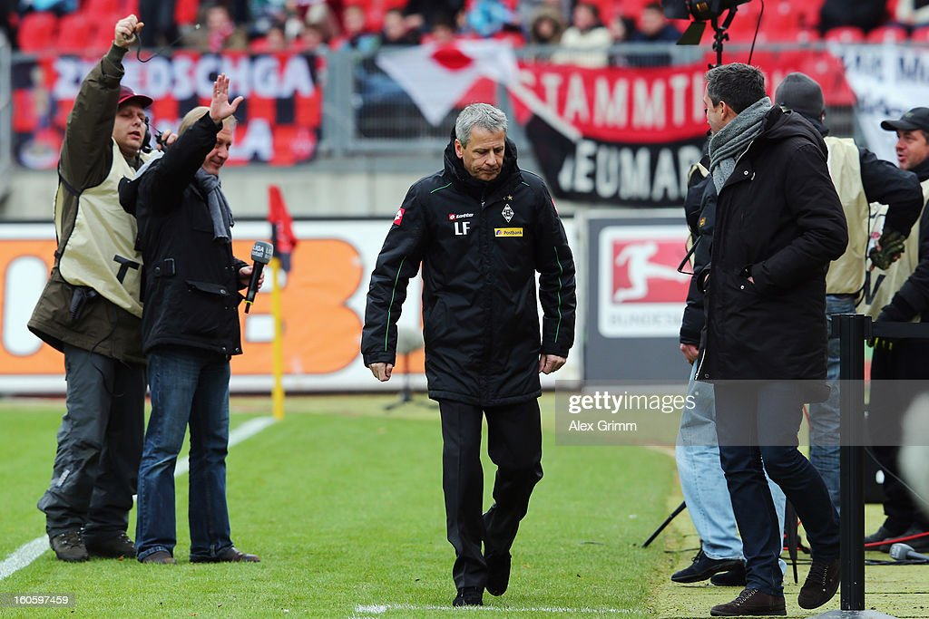Head coach Lucien Favre of Moenchengladbach walks along the pitch prior to the Bundesliga match between 1. FC Nuernberg and VfL Borussia Moenchengladbach at Easy Credit Stadium on February 3, 2013 in Nuremberg, Germany.
