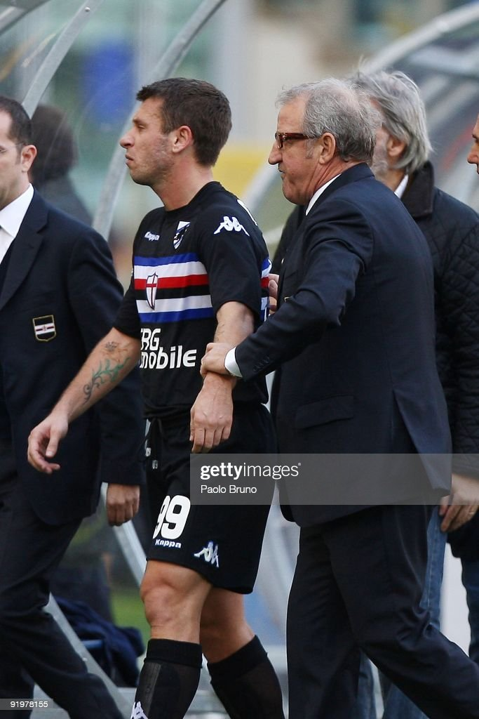 Head coach Luigi Del Neri (R) of Sampdoria assists <a gi-track='captionPersonalityLinkClicked' href=/galleries/search?phrase=Antonio+Cassano&family=editorial&specificpeople=214558 ng-click='$event.stopPropagation()'>Antonio Cassano</a> from the field of play after the Serie A match between SS Lazio and UC Sampdoria at Stadio Olimpico on October 18, 2009 in Rome, Italy.