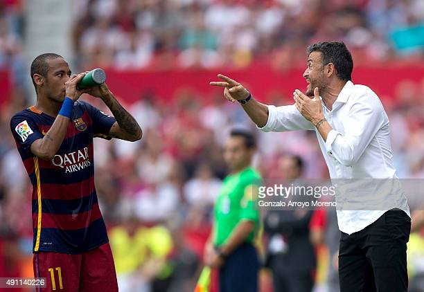 Head coach Luis Enrique Martinez of FC Barcelona gives instructions to his player Neymar JR during the La Liga match between Sevilla FC and FC...