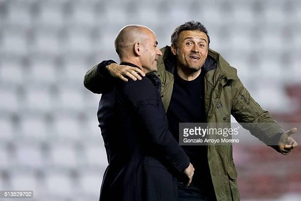 Head coach Luis Enrique Martinez of FC Barcelona jokes with coach Paco Jemez of Rayo Vallecano de Madrid during the La Liga match between Rayo...