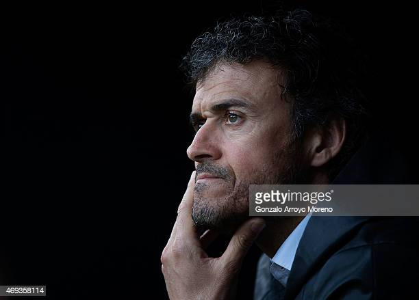 Head coach Luis Enrique Martinez of FC Barcelona reacts sitted on the bench prior to start the La Liga match between Sevilla FC and FC Barcelona at...