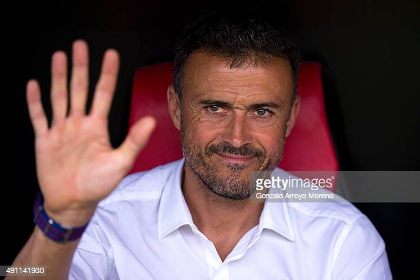 Head coach Luis Enrique Martinez of FC Barcelona waves sitted on the bench prior to start the La Liga match between Sevilla FC and FC Barcelona at...