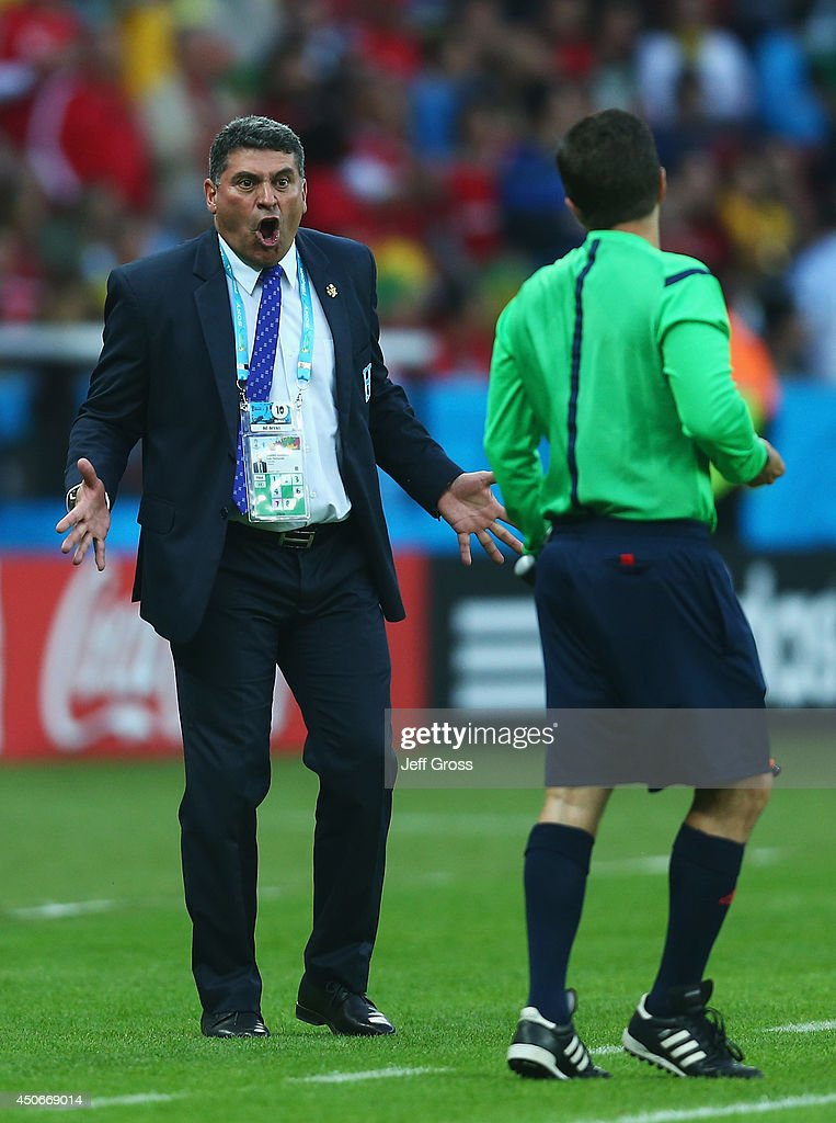 Head coach <a gi-track='captionPersonalityLinkClicked' href=/galleries/search?phrase=Luis+Fernando+Suarez+-+Soccer+Coach&family=editorial&specificpeople=548216 ng-click='$event.stopPropagation()'>Luis Fernando Suarez</a> of Honduras reacts towards the assistant referee after France's second goal during the 2014 FIFA World Cup Brazil Group E match between France and Honduras at Estadio Beira-Rio on June 15, 2014 in Porto Alegre, Brazil.