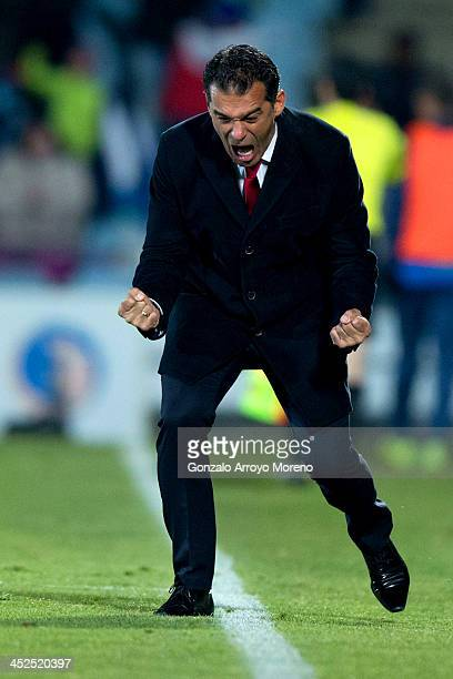 Head coach Luis Garcia of Getafe CF celebrates his team's first goal during the La Liga match between Getafe CF and Levante UD at Coliseum Alfonso...