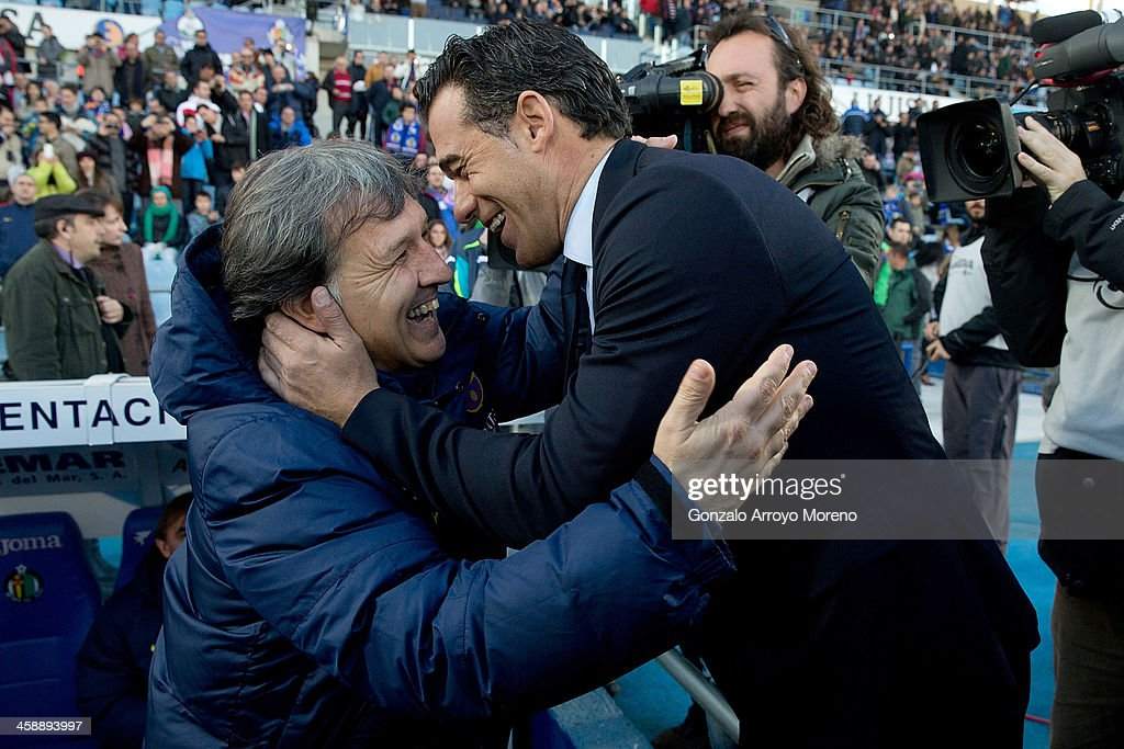 Head coach Luis Garcia (R) of Getafe CF embraces head coach Gerardo Tata Martino (L) of FC Barcelona prior to start the La Liga match between Getafe CF and FC Barcelona at Coliseum Alfonso Perez on December 22, 2013 in Getafe, Spain.