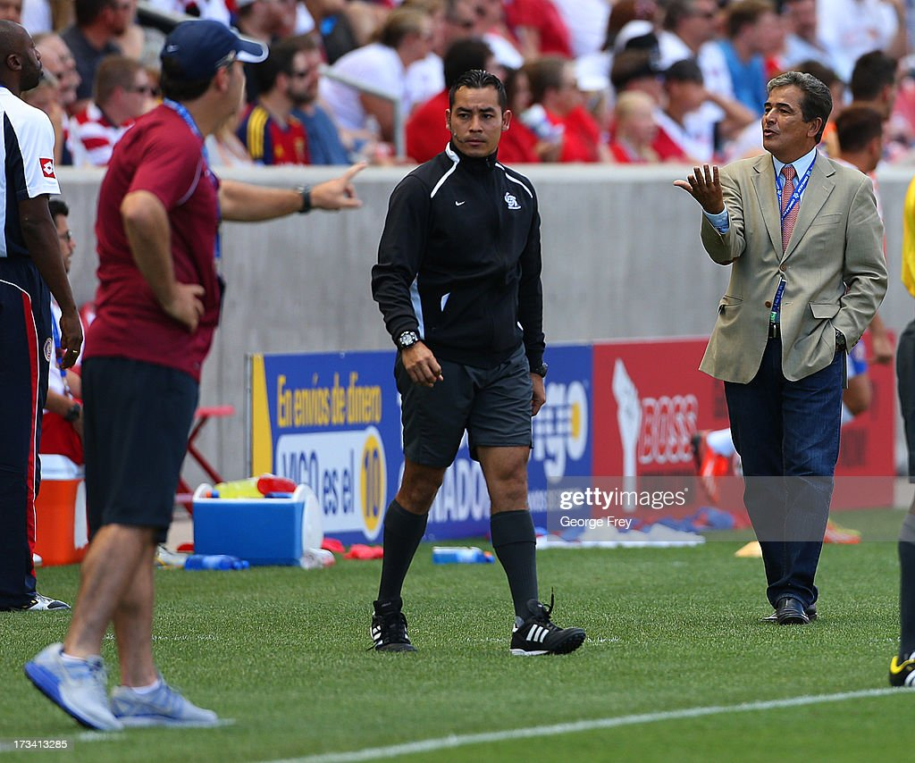 Head coach Luis Pinto (R) of Costa Rica and head coach Ian Mork of Belize exchange words during the first half of a CONCACAF Gold Cup match July 13, 2013 at Rio Tinto Stadium in Sandy, Utah. Costa Rica defeated Belize 1-0.