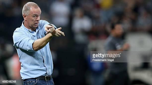 Head coach Luiz Antonio Venker Menezes of Corinthians gives advise during the match between Corinthians and Coritiba for the Brazilian Series A 2014...