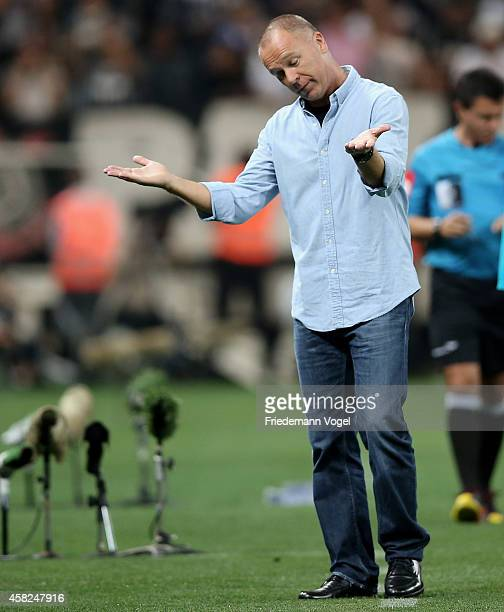 Head coach Luiz Antonio Venker Menezes of Corinthians looks on during the match between Corinthians and Coritiba for the Brazilian Series A 2014 at...
