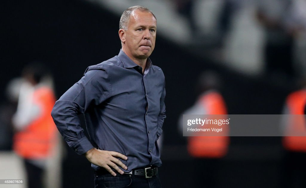 Head coach <a gi-track='captionPersonalityLinkClicked' href=/galleries/search?phrase=Luiz+Antonio+Venker+Menezes&family=editorial&specificpeople=4310147 ng-click='$event.stopPropagation()'>Luiz Antonio Venker Menezes</a> of Corinthians reacts during the match between Corinthians and Goias for the Brazilian Series A 2014 at Arena Corinthians on August 21, 2014 in Sao Paulo, Brazil.