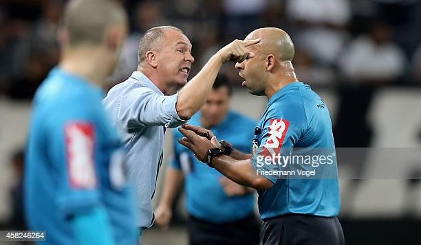 Head coach Luiz Antonio Venker Menezes of Corinthians talks to the referee Jean Pierre Goncalves Lima during the match between Corinthians and...