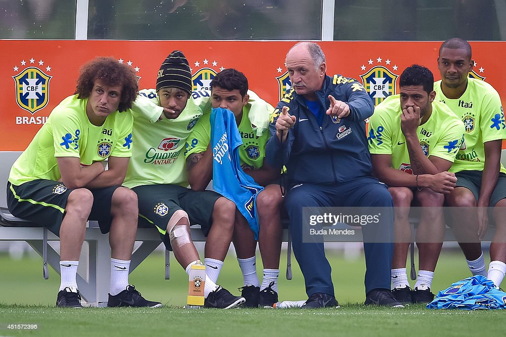 Head coach Luiz Felipe Scolari (C) gives instructions for <a gi-track='captionPersonalityLinkClicked' href=/galleries/search?phrase=David+Luiz&family=editorial&specificpeople=4133397 ng-click='$event.stopPropagation()'>David Luiz</a> (L), Neymar (2nd-L), Thiago Silva (3rd-L), Hulk (2rd-R) and Fernandinho (R) during a training session of the Brazilian national football team at the squad's Granja Comary training complex, on July 01, 2014 in Teresopolis, 90 km from downtown Rio de Janeiro, Brazil.