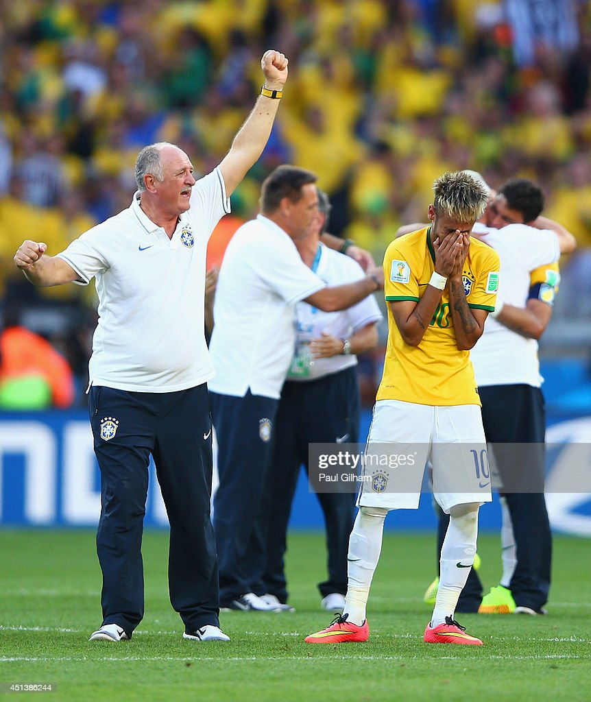 Head coach <a gi-track='captionPersonalityLinkClicked' href=/galleries/search?phrase=Luiz+Felipe+Scolari&family=editorial&specificpeople=233747 ng-click='$event.stopPropagation()'>Luiz Felipe Scolari</a> of Brazil and Neymar react during the penalty shootout in the 2014 FIFA World Cup Brazil round of 16 match between Brazil and Chile at Estadio Mineirao on June 28, 2014 in Belo Horizonte, Brazil.